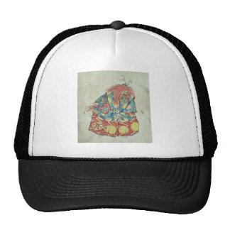 Un payaso que lleva el traje y la máscara colorido gorra