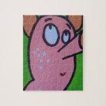 Un pequeño cerdo puzzle con fotos