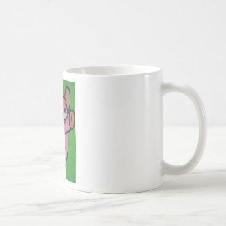 Un pequeño cerdo taza de café