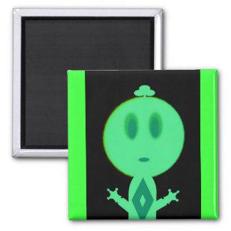 Un pequeño hombre verde imán cuadrado