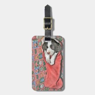 Un perrito para el navidad etiqueta para maleta