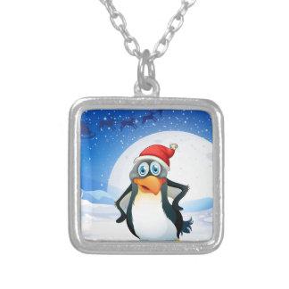 Un pingüino que lleva el gorra de Santa Colgante Cuadrado