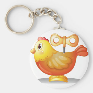 Un pollo del juguete llavero redondo tipo chapa