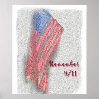 """Un poster de la bandera americana con """"recuerda 9/"""