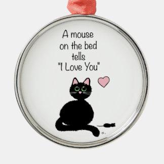 Un ratón en la cama adorno