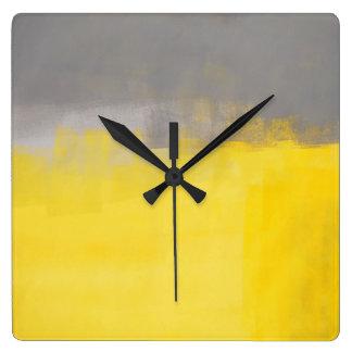 """"""""""" Un reloj gris y amarillo abstracto simple del"""