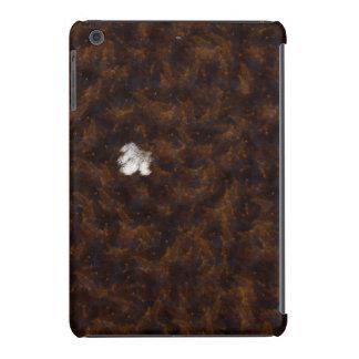 Un remiendo del blanco rodeado por el marrón fundas de iPad mini