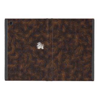 Un remiendo del blanco rodeado por el marrón iPad mini carcasa