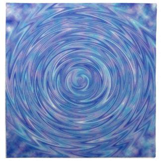 Un remolino abstracto del color en azul y púrpura servilleta de papel