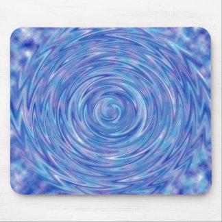 Un remolino abstracto del color en azul y púrpura alfombrillas de ratones