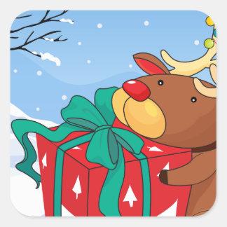 Un reno que sostiene un regalo pegatina cuadrada