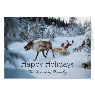 Un reno que tira de Papá Noel y de su trineo Tarjeta De Felicitación