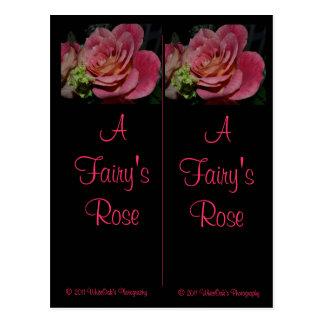 Un rosa de hada marca una dirección de la Internet Tarjeta Postal