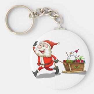 Un Santa sonriente que tira de un trineo Llavero Redondo Tipo Pin