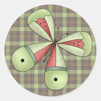 Un sello (verde) de la letra de la mariposa del pegatina redonda