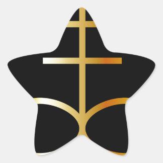 Un símbolo de oro de la cruz o del azufre del pegatina en forma de estrella