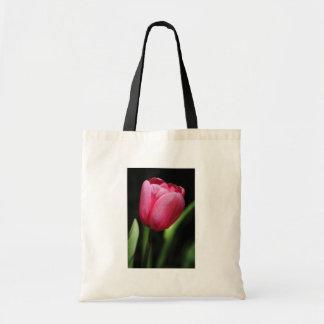 Un solo tulipán bolsas de mano