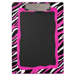 Un tablero rosado y blanco del estampado de zebra