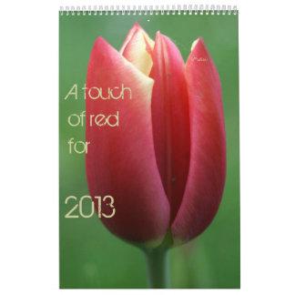 un tacto del rojo para 2013 calendario de pared