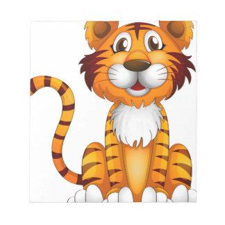 Un tigre que se sienta blocs de papel