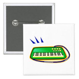 Un verde keytar con un gráfico azul de la correa, pin