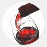 Un vidrio de vino rojo pegatina redonda