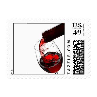 Un vidrio de vino rojo sello