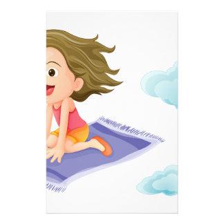 Un vuelo del chica en la estera papeleria