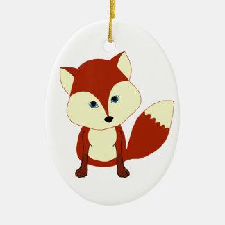Un zorro rojo lindo adorno navideño ovalado de cerámica