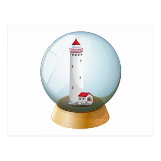 Una bola de cristal con un faro inside.pdf tarjeta postal