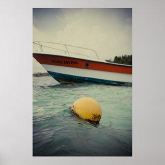 Una boya y un barco en el agua posters