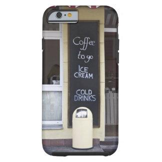 una cafetería con un café a ir muestra funda resistente iPhone 6