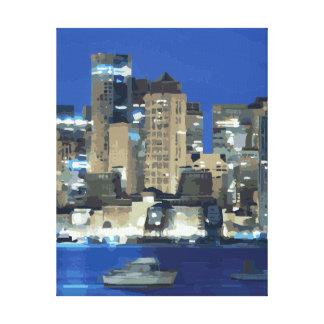Una ciudad de luces chispeantes sobre la bahía impresión de lienzo