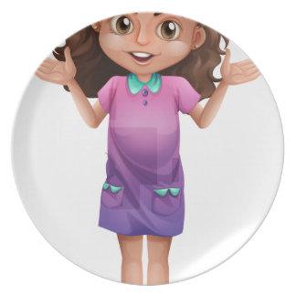 Una colegiala linda con los hairclips plato de comida