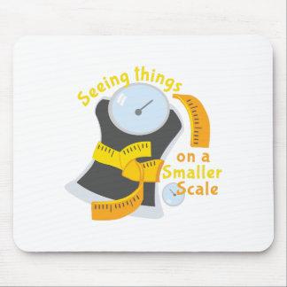 Una escala más pequeña alfombrillas de ratones