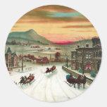 Una escena del navidad del país pegatina redonda