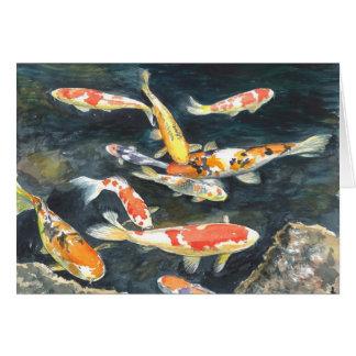 Una escuela de los pescados de Koi en una charca Tarjeta De Felicitación