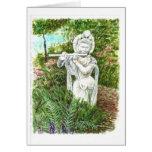 Una estatua de una señora con una flauta felicitaciones