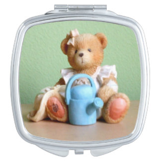 Una estatuilla deliciosa del oso de peluche espejo para el bolso