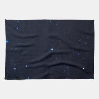 Una estrella que apresura se coge en la cámara de  toalla