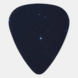 Una estrella que apresura se coge en la cámara de  púa de guitarra