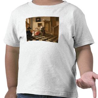 Una familia en un interior camisetas