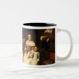 Una familia flamenca en la cena taza de café de dos colores