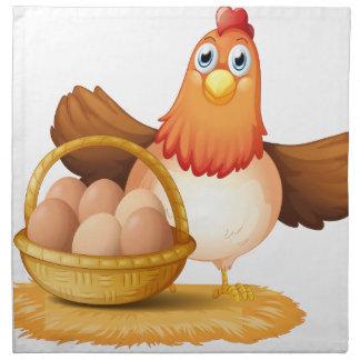 Una gallina y una cesta de huevo servilleta
