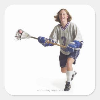 una hembra caucásica adolescente en un jersey pegatina cuadrada