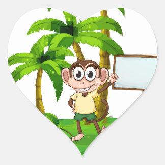 Una isla con un mono y un letrero pegatina en forma de corazón