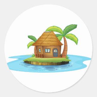 Una isla con una pequeña choza del nipa pegatina redonda