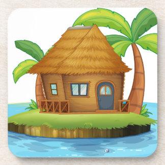 Una isla con una pequeña choza del nipa posavasos de bebida