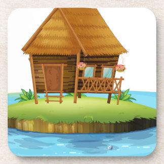 Una isla con una pequeña choza del nipa posavaso