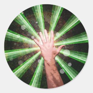 Una mano pegatina redonda